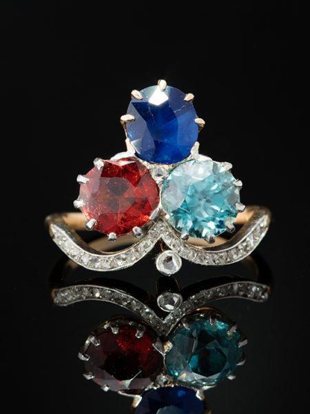 ANTIQUE ART NOUVEAU SAPPHIRE HESSONITE GARNET ZIRCON AND DIAMOND FLOWER CLOVER THREE STONE RING