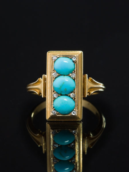 VICTORIAN PERSIAN TURQUOISE AND DIAMOND ARCHAEOLOGICAL REVIVAL THREE STONE RING