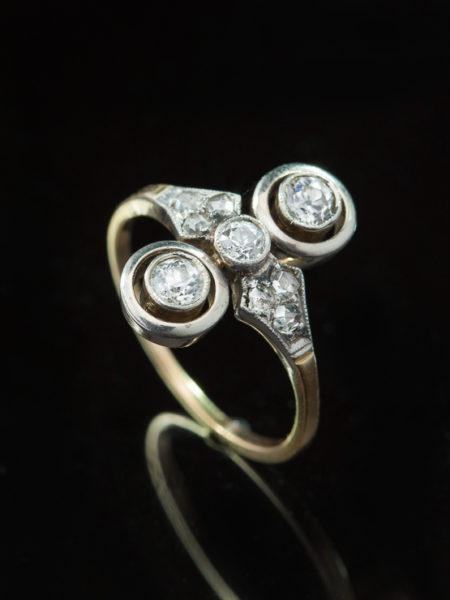 ANTIQUE ART DECO DIAMOND THREE STONE HALO TARGET RING
